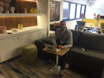 Legalese lawyer Thomas Reisenberger sitting behind laptop in workspace